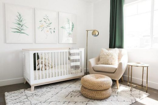 White And Green Nursery Features Three Botanical Prints Placed Over A Babyletto Scoot Convertible Crib With Toddler Rail Drape Din Gray Striped Throw