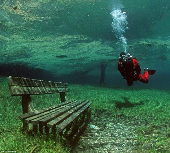 A MUST! Austria's Green Lake in the Hochschwab Mountains is a hiking trail in the winter. The snow melts in early summer and creates a completely clear lake. The lake has a grassy bottom, complete with underwater trails, park benches, and bridges.