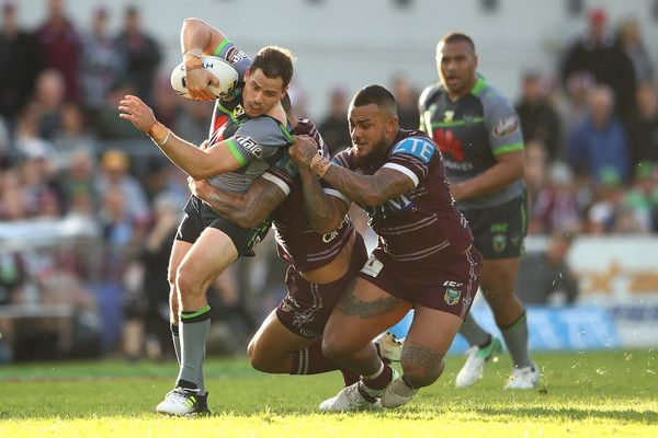 Aiden Sezer of the Raiders is tackled during the round 13 NRL match between the Manly Sea Eagles and the Canberra Raiders at Lottoland on June 4, 2017 in Sydney, Australia.