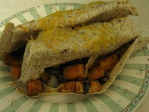 Black Bean Sweet Potato Burritos. This picture doesn't do this delicious recipe justice. I love it with sour cream and mango salsa. #favorites