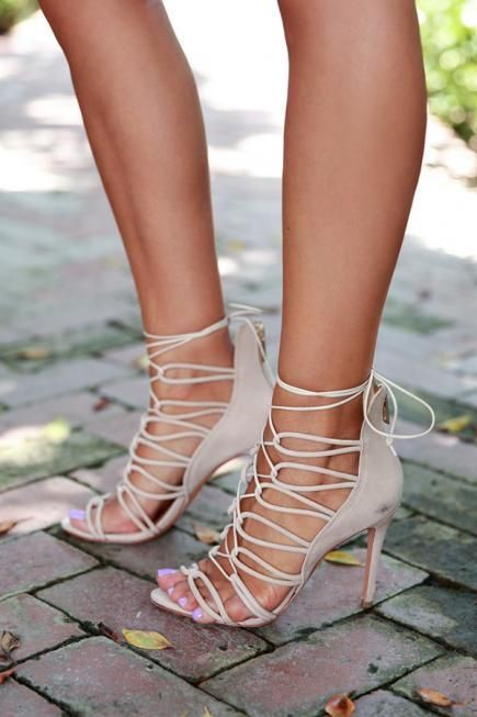 Thin, strappy sandals, like this pair on Anabelle of VivaLuxury, are a major trend for the season. #Shoes #shoelover