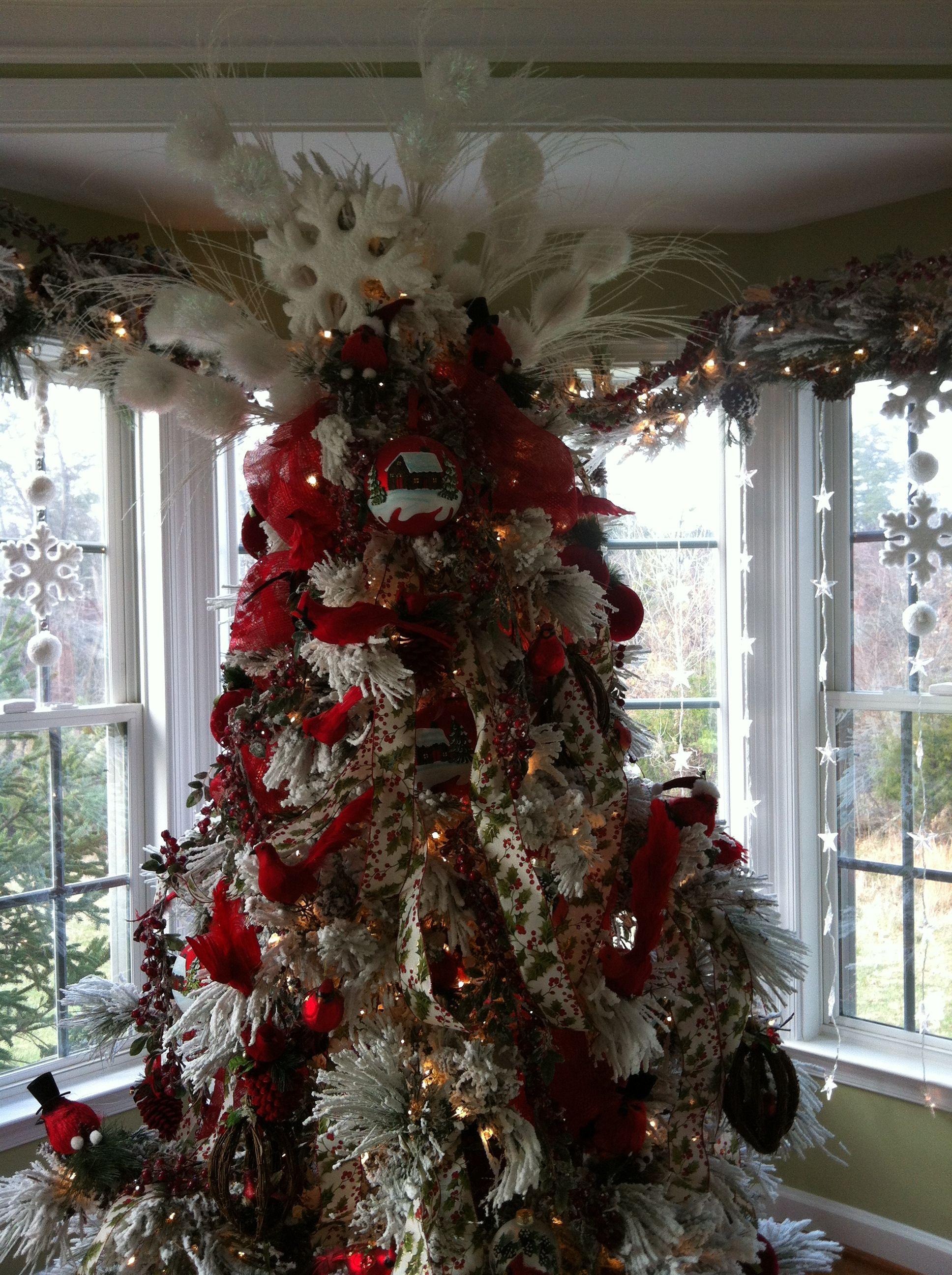 flocked christmas tree decorated christmas trees. Black Bedroom Furniture Sets. Home Design Ideas