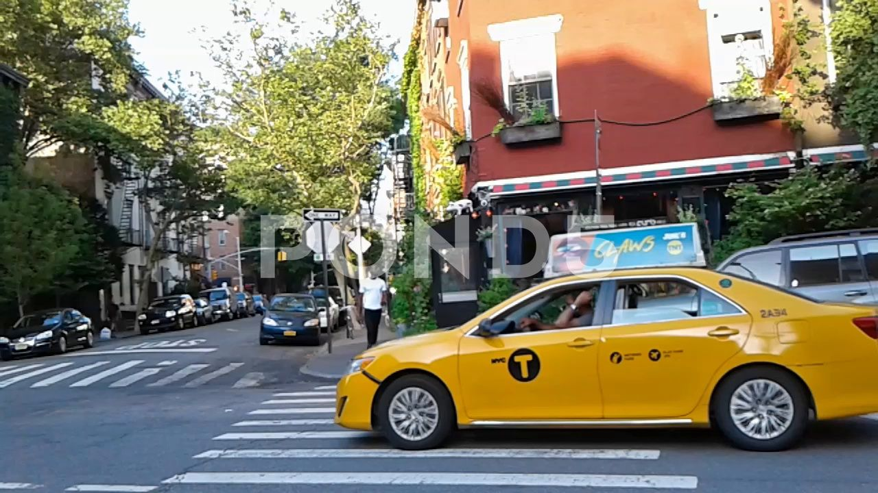 Yellow taxi on a sunny day in New York City Stock Footage sunnydayYellowtaxi
