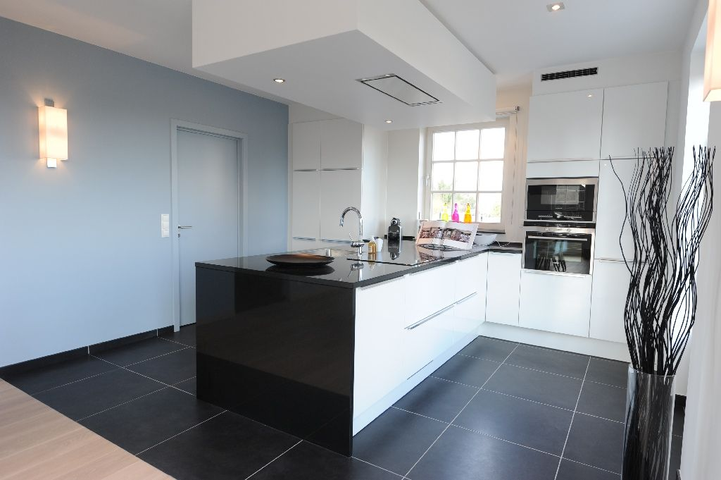 hoe kies je de juiste dampkap foto moderne keuken eiland dampkap plafond. Black Bedroom Furniture Sets. Home Design Ideas