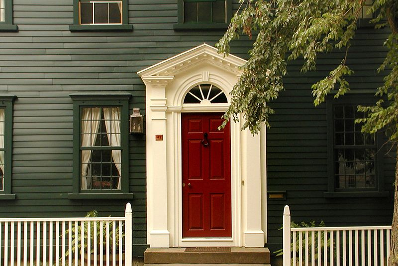 Love The Red Door In Contrast With White Trim And Dark House