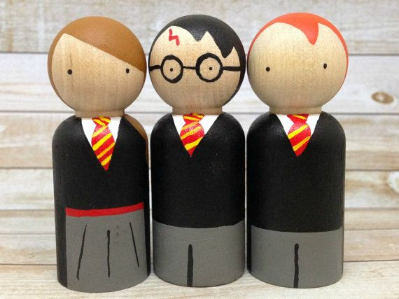 The Harry Potter Peg Doll Set by PeggedByGrace on Etsy...This peg doll set includes Harry Potter, Hermione Granger, and Ron Weasley. They are 2 5/8 inches high, painted with non-toxic paints and non-toxic sealer