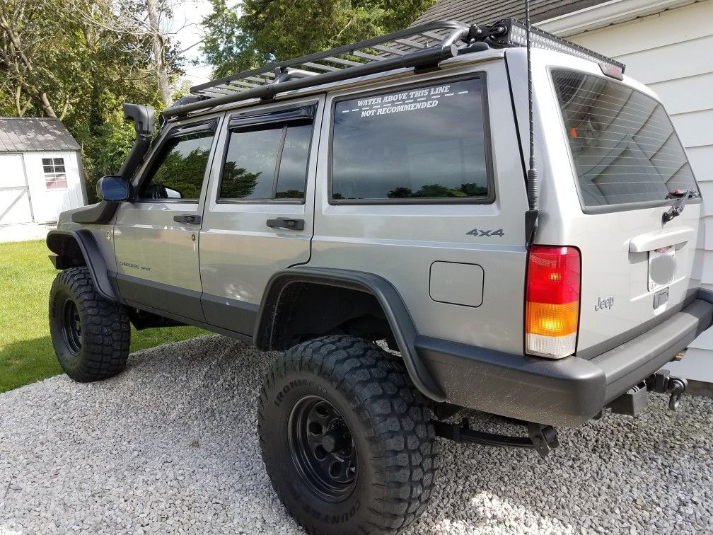 silver jeep xj lifted
