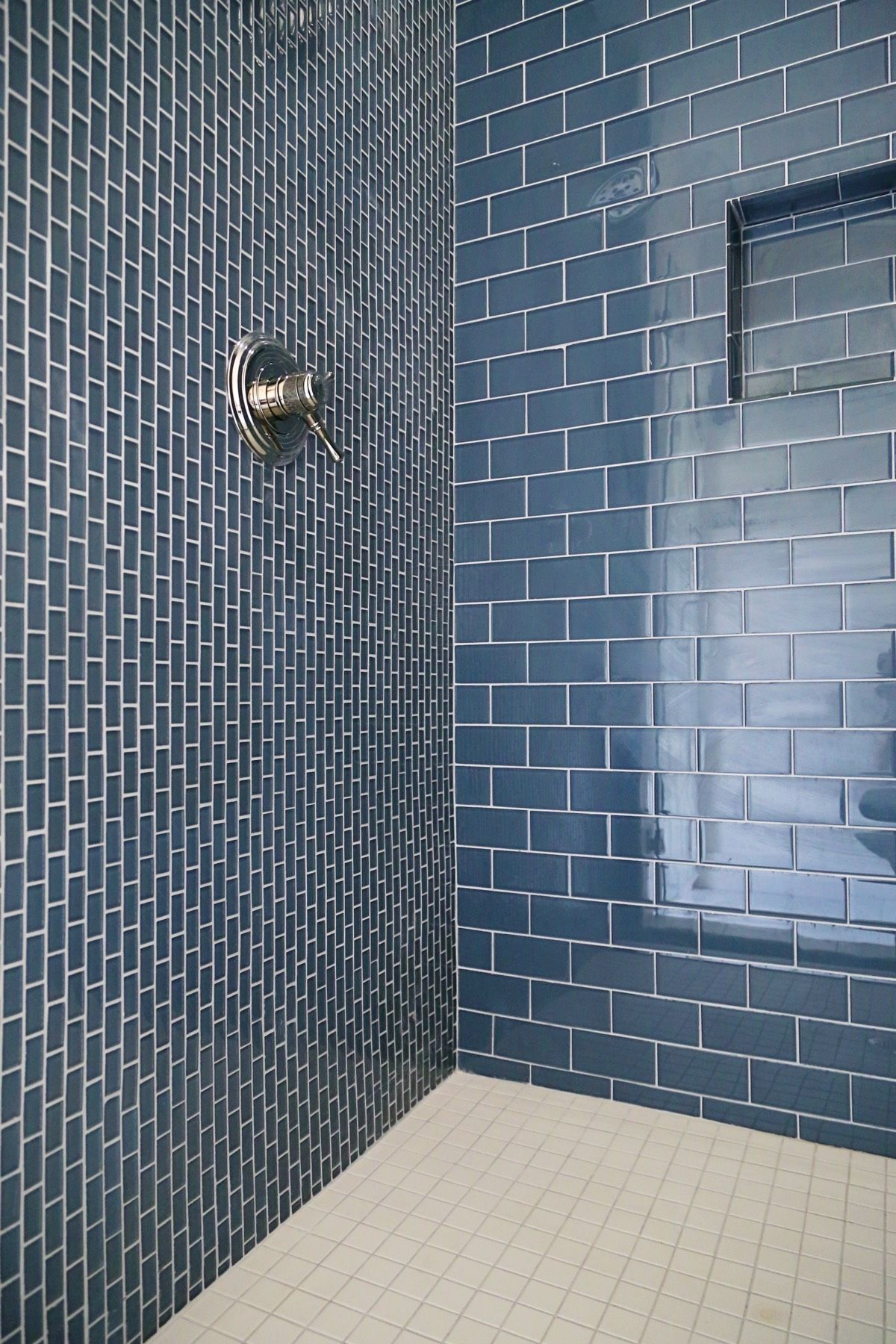 Blue glass tile, block shower, recessed shower shelf saves space ...