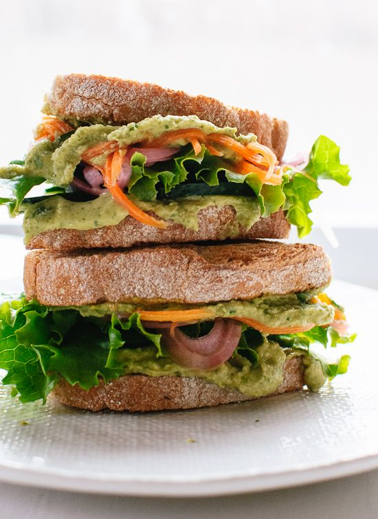 This healthy hummus sandwich recipe features crisp cucumbers, tangy quick-pickled red onions and carrots, lettuce and herbed hummus! A quick and easy lunch.