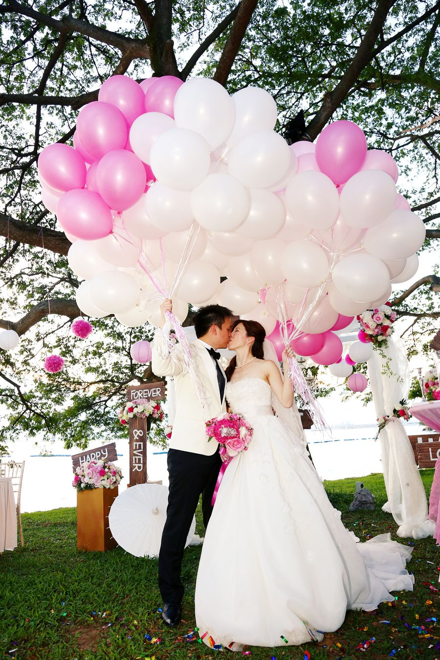 Wedding couple posing with balloons | Pink and White Wedding at Shangri-La's Rasa Sentosa Resort: Tris and Jacqueline