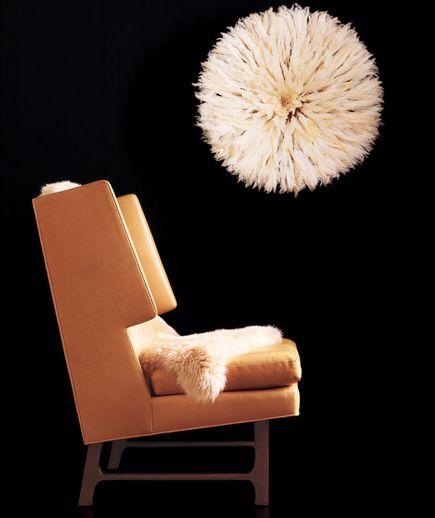 Elephant chair, sheepskin rug, and feather headdress