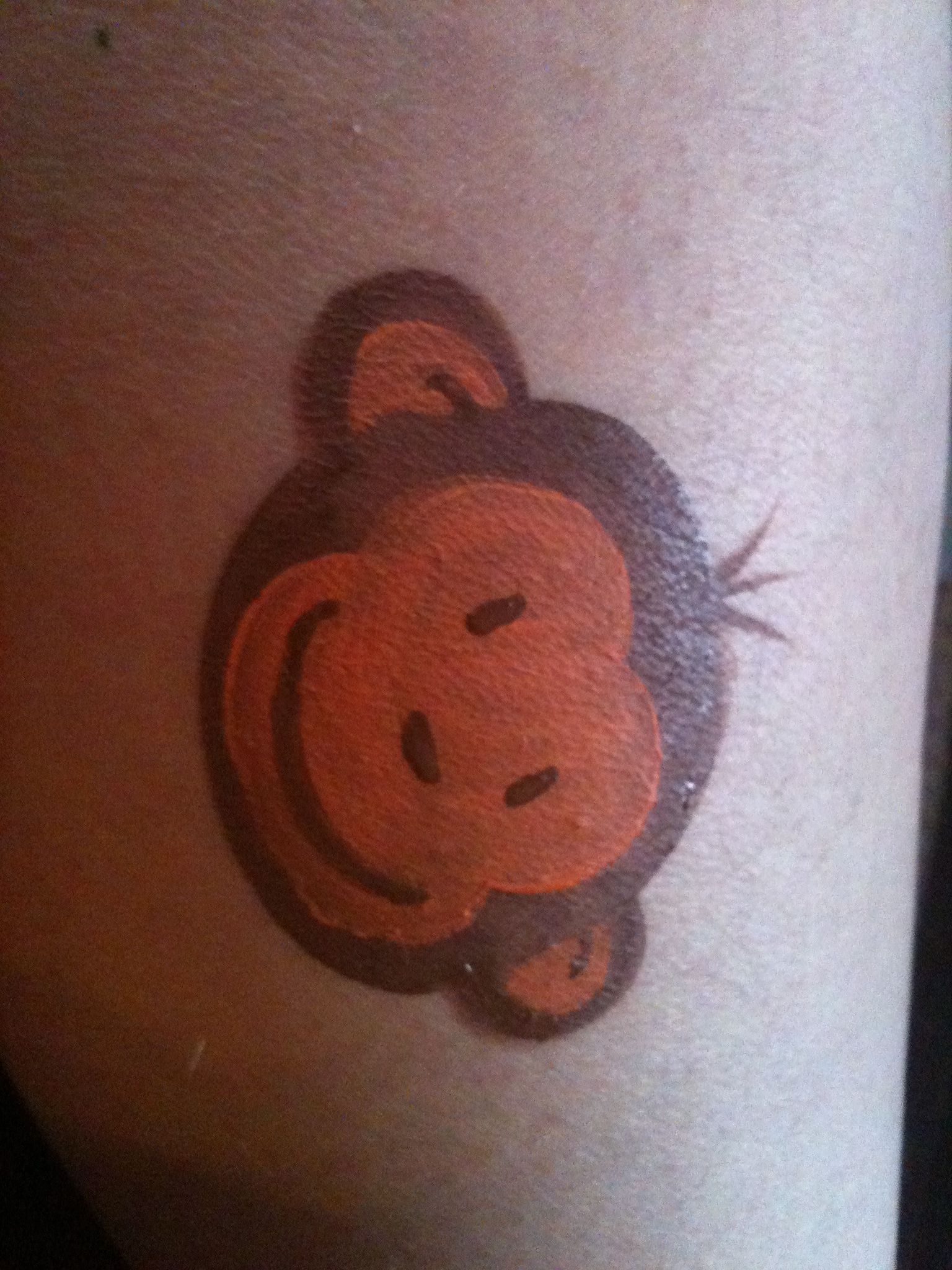 Monkey by Spots and Dots Face Painting
