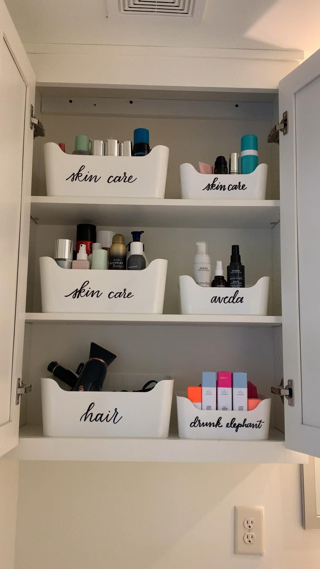 Photo of Hair care, skin care, and everyday products are labeled and in order. Giving eve…
