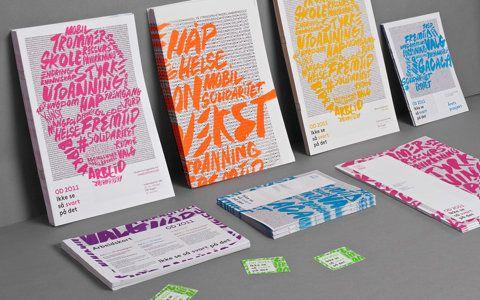 Colour font over black copy. Print.