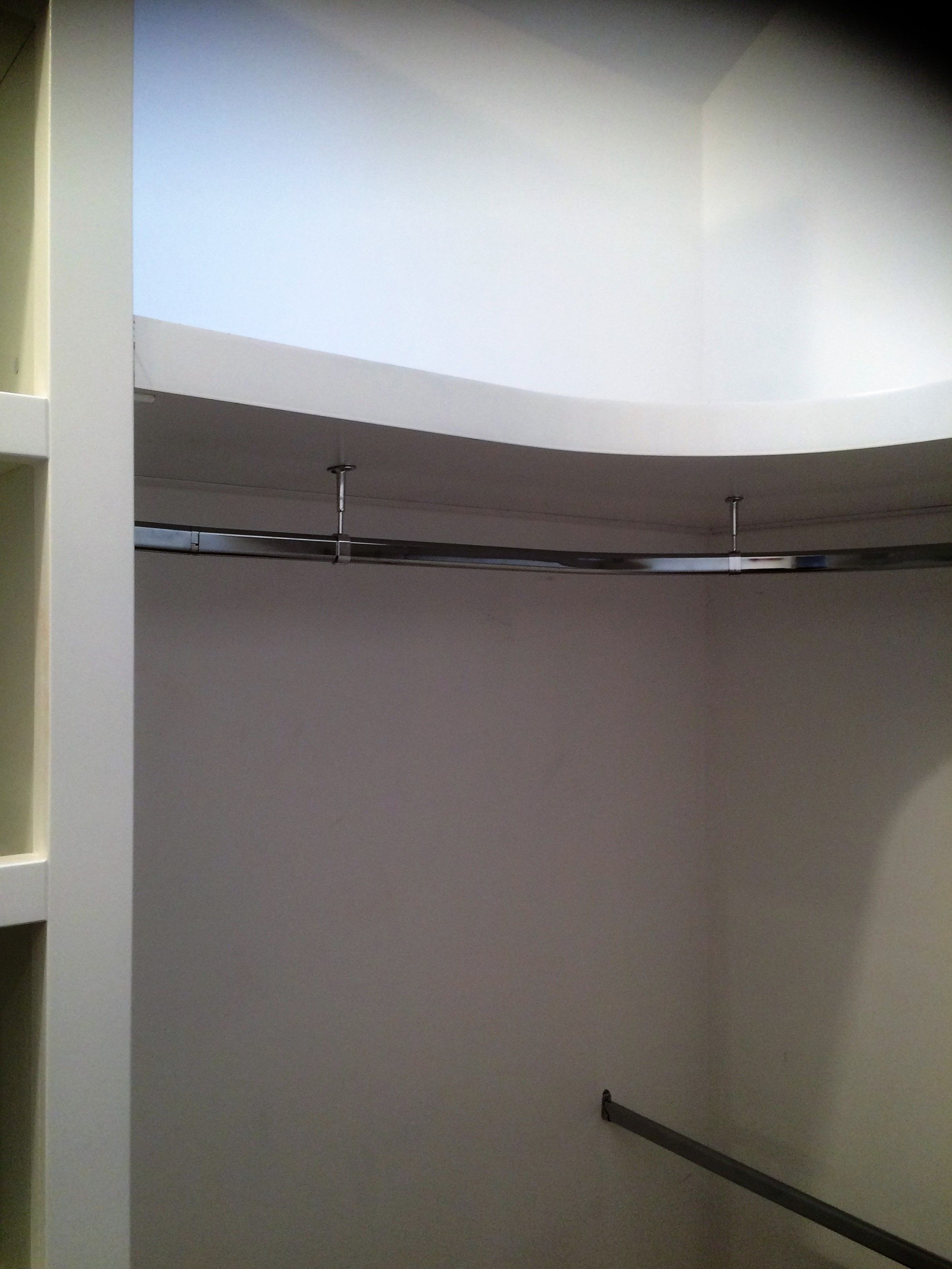 Curved Floating Shelf With Curved And Straight Rails In