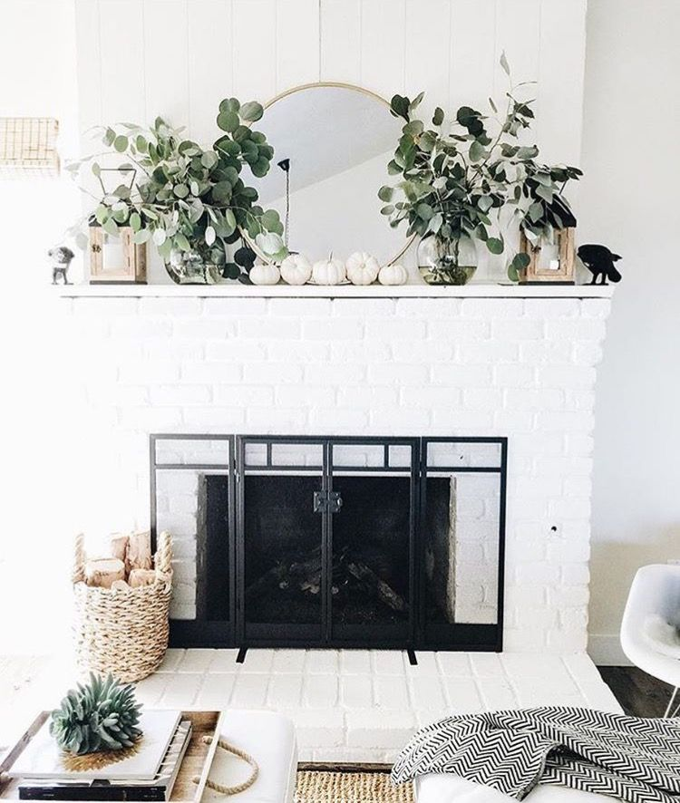 Pleasing White Brick Fireplace Round Mirror Hanging Above Hearth Download Free Architecture Designs Grimeyleaguecom