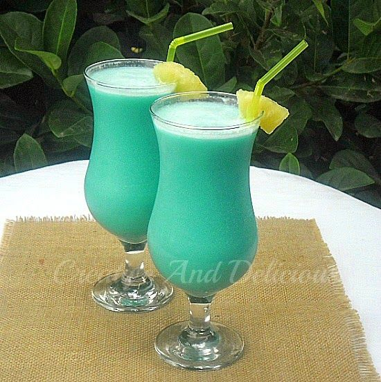 Blue Hawaiian ~ One of the MOST Tropical cocktails around and a must have for lounging around the pool !