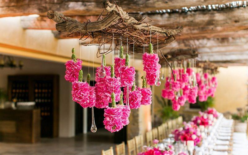 hanging flowers pink floral arrangements destination weddings mexico