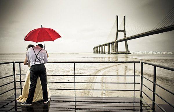 under a red umbrella