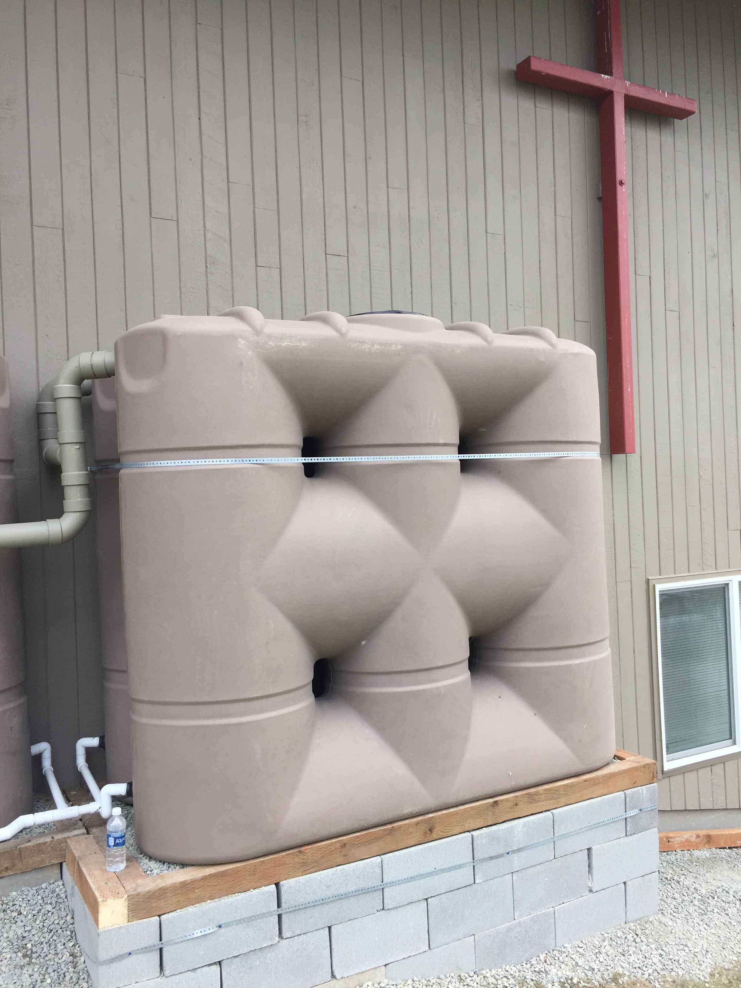 7 x 530 gallon rainwaterharvesting tanks with images