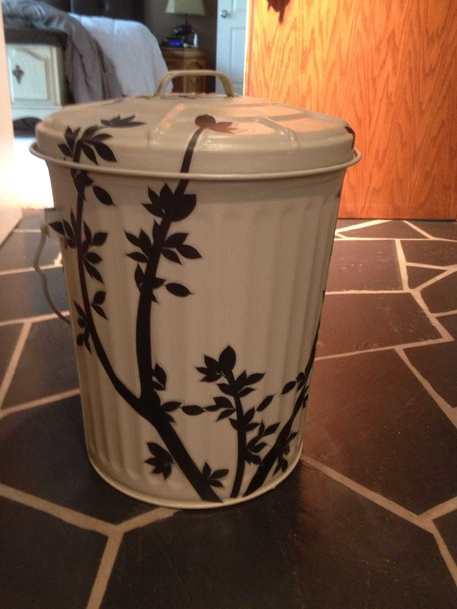 took a metal trash can painted it with the exterior trim of our house color