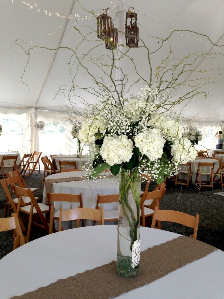 Tall white wedding centerpiece with babys breath