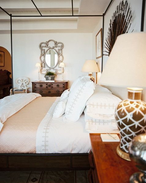 Bedroom Photo - An iron canopy bed paired with a wooden bedside table