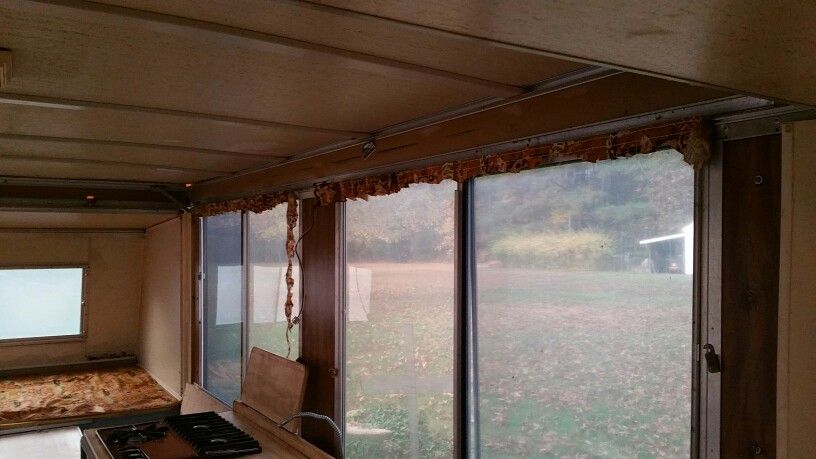 Removed old curtains. Several windows need new plexiglass