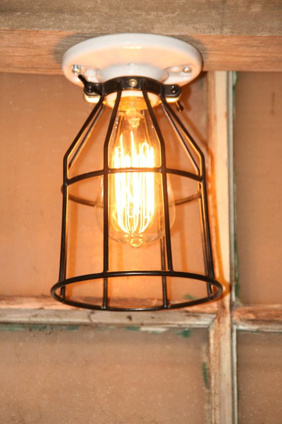 Industrial Light Vintage Style Porcelain Mount Fixture with Rubber Coated Cage Guard. $22.00, via Etsy.