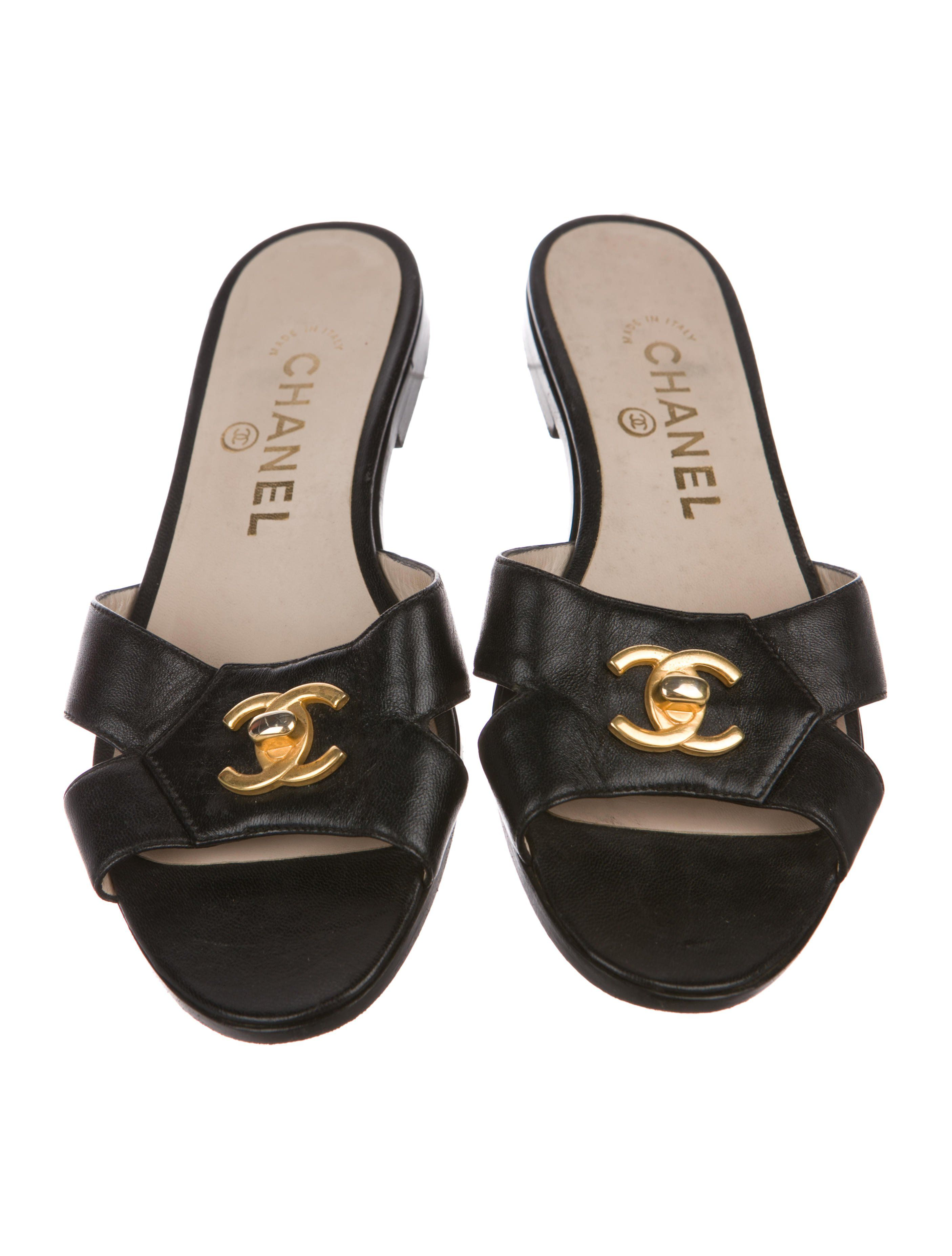 Black lambskin vintage Chanel sandals with CC turn-lock detail at vamps and  stacked heels.