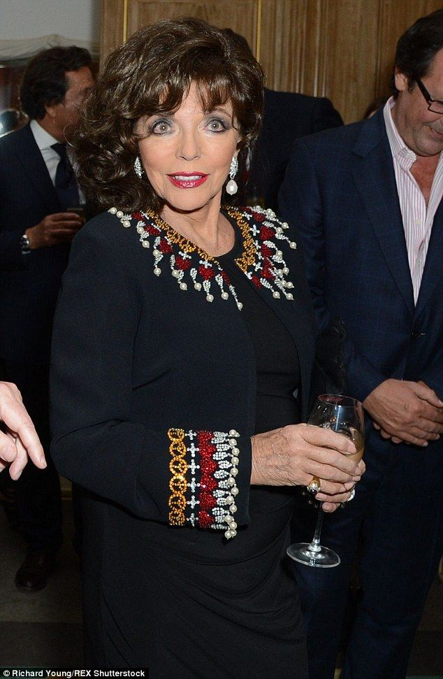 Brave face: Dame Joan Collins attended the launch of Portraits Of The World's Most Stylish Women in London on Tuesday night following the death of her sister Jackie on Saturday