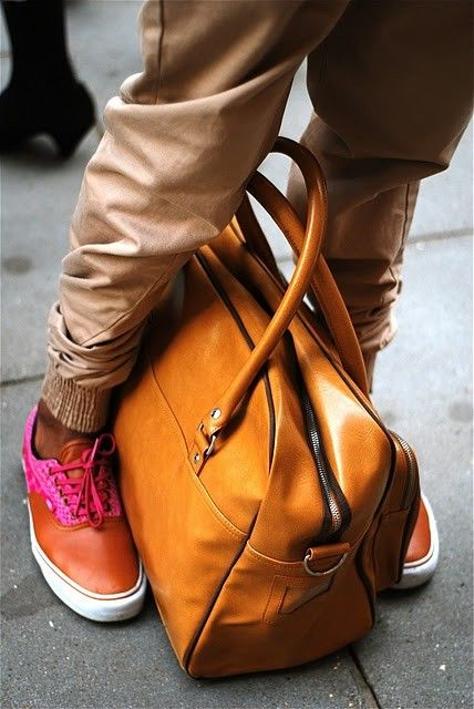 Great bag, pant, brite colored shoes... Luv a man that ISNT afraid 2B different... Nicely done!!