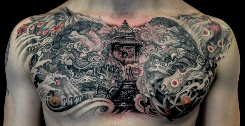 Chronic Ink Tattoo - Toronto Tattoo Foo dogs and temple tattoo on the chest by Winson.