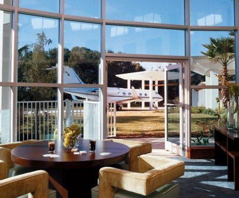 John Travolta and Kelly Preston's Airport Terminal inspired Florida home
