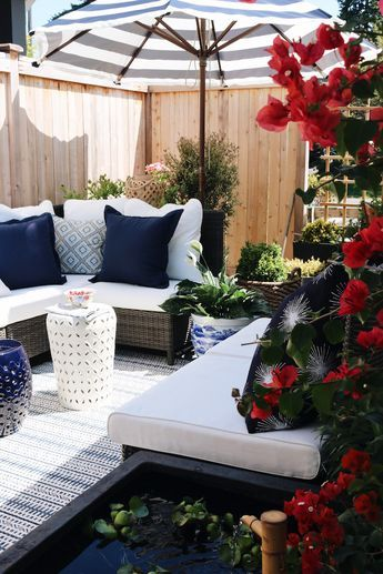 The-Inspired-Room-Side-Yard-Design-Outdoor-Sectional-with-Umbrella-and-Patio-Fountain