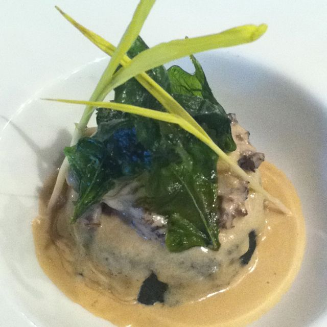 Spinach patty stuffed with panner cheese and pistachio serve with saffron garlic cream morel mushroom sauce