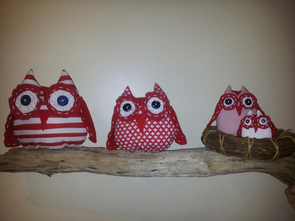 Owls on driftwood.