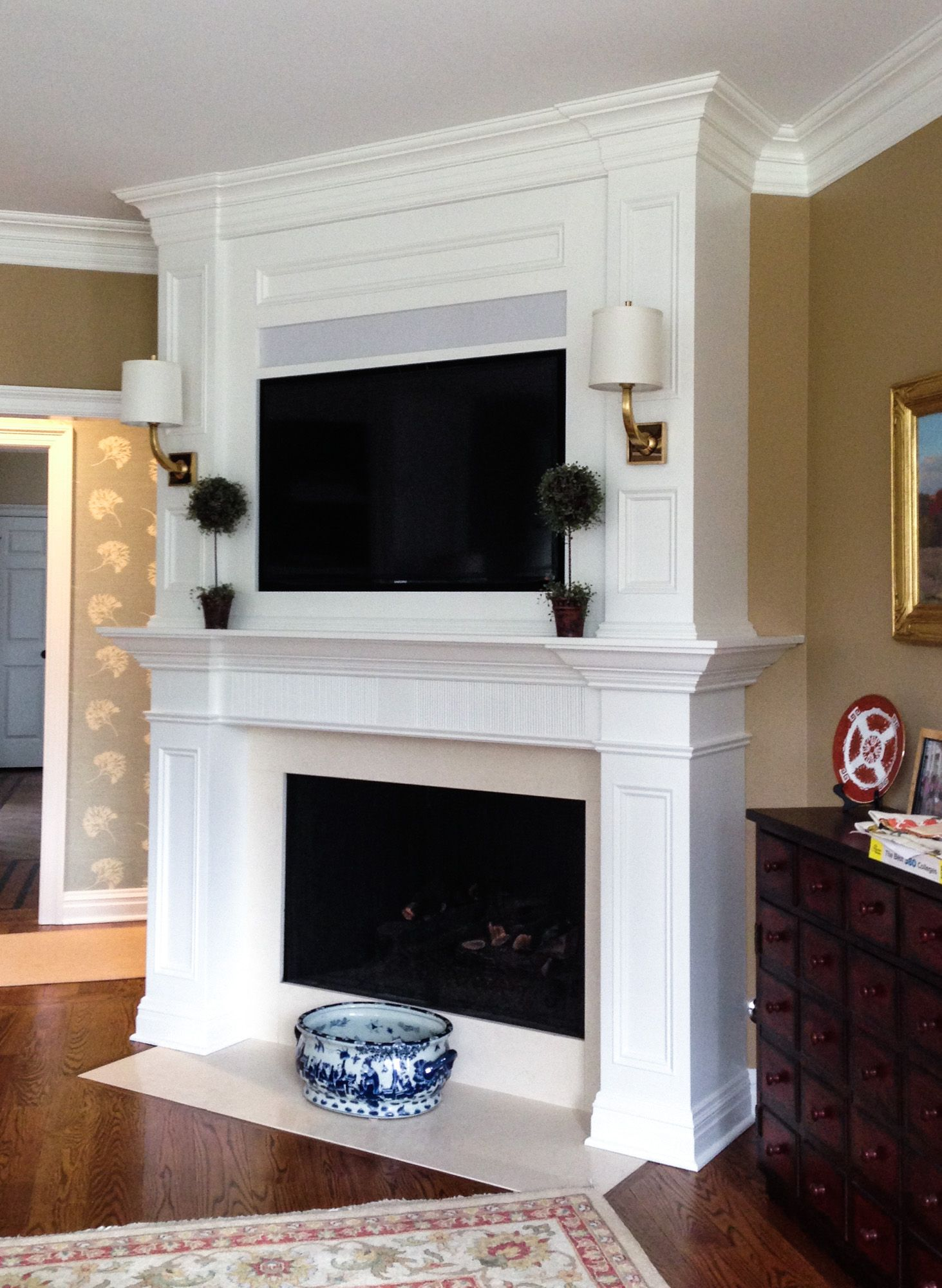 Custom builtin fireplace surround with tv lighting
