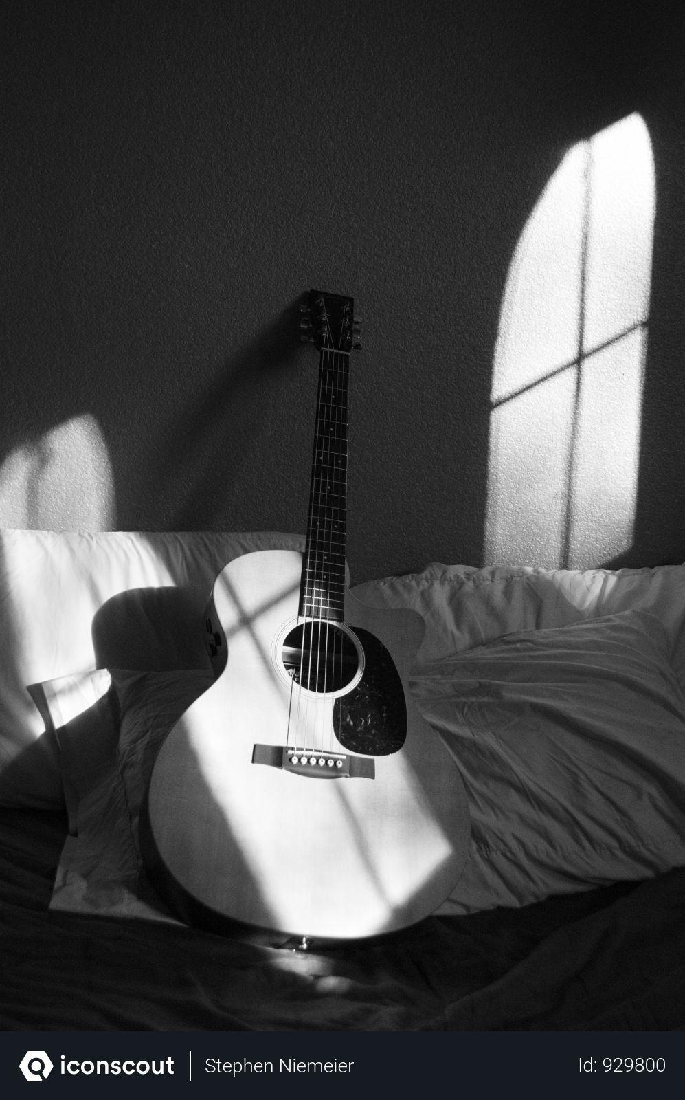 Free White Acoustic Guitar On Grey And White Textile Photo ...
