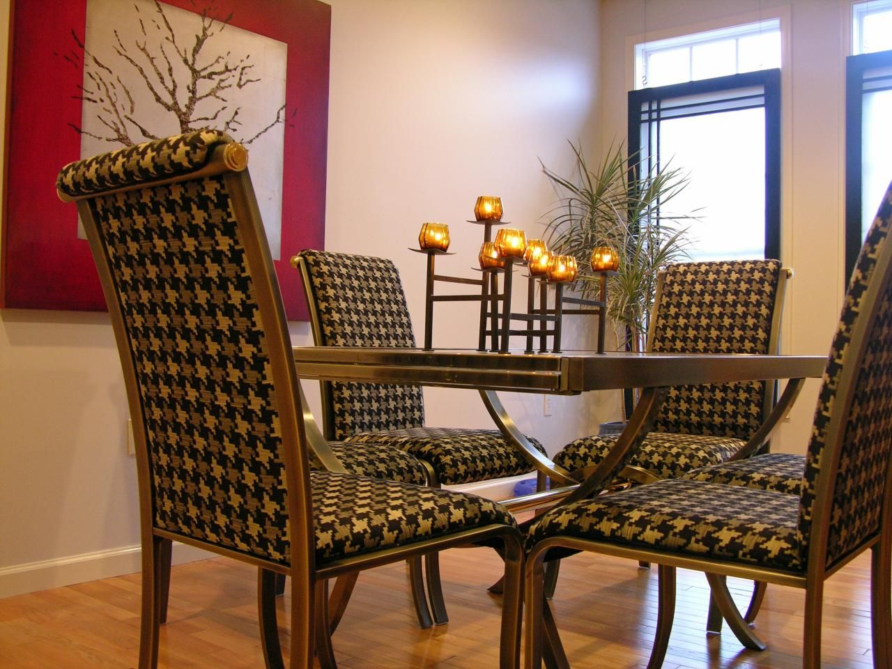 Four Dining Room Chairs In A Houndstooth Pattern Upholstery Are The Visual  Standout In This Transitional