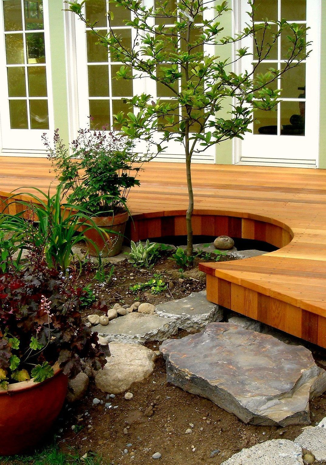 How Much Does It Cost To Build A Deck A Complete Cost Guide Building A Deck Small Outdoor Patios Building A Pergola