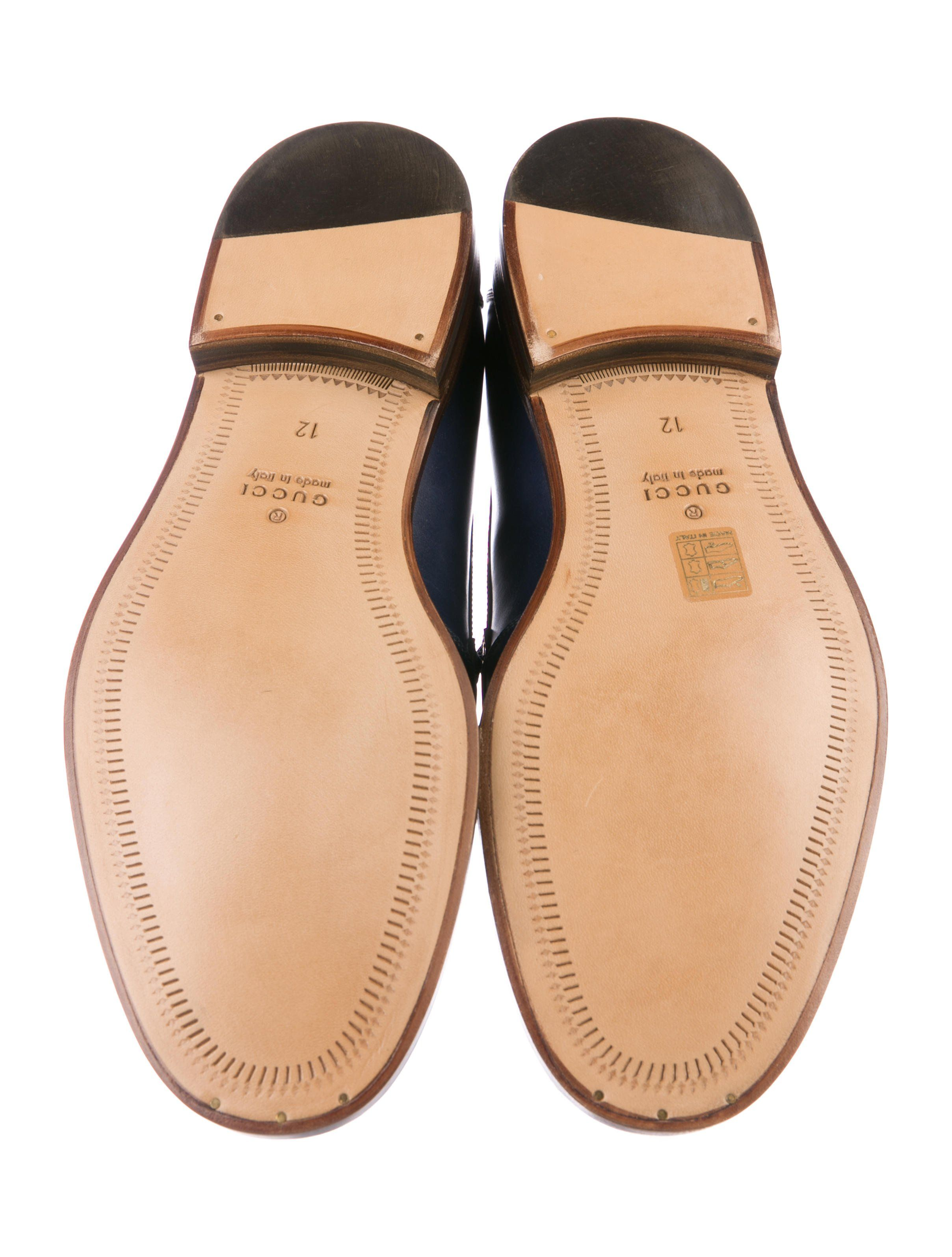 f38e23144ae Men s navy leather Gucci round-toe penny loafers with Web trim at counters  and stacked heels. Includes box and dust bag.