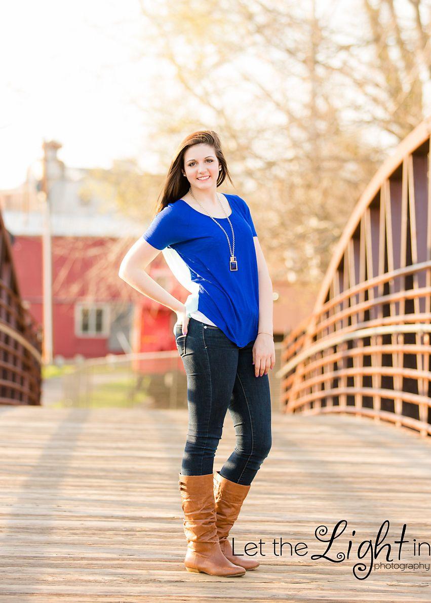 High School Girl standing on the iron bridge on the warrenton greenway.