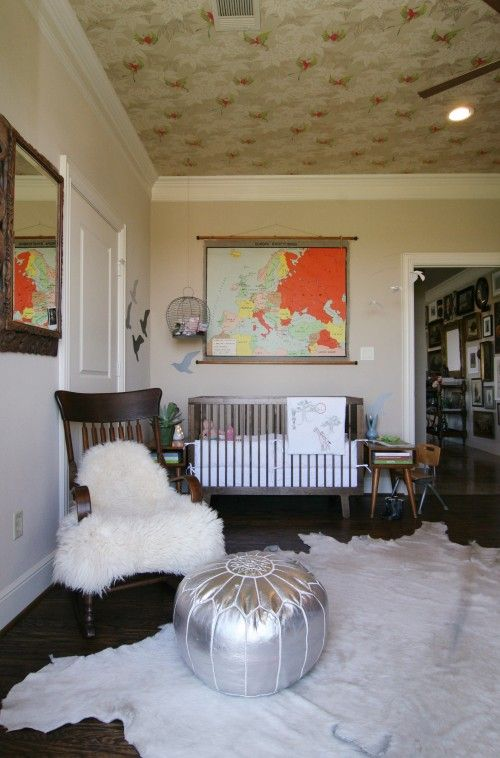 wallpapered ceiling + map + birdcage + end tables