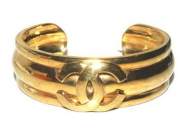Chanel Sleek Heavy Goldtone ,raised CC Logo Bangle Bracelet