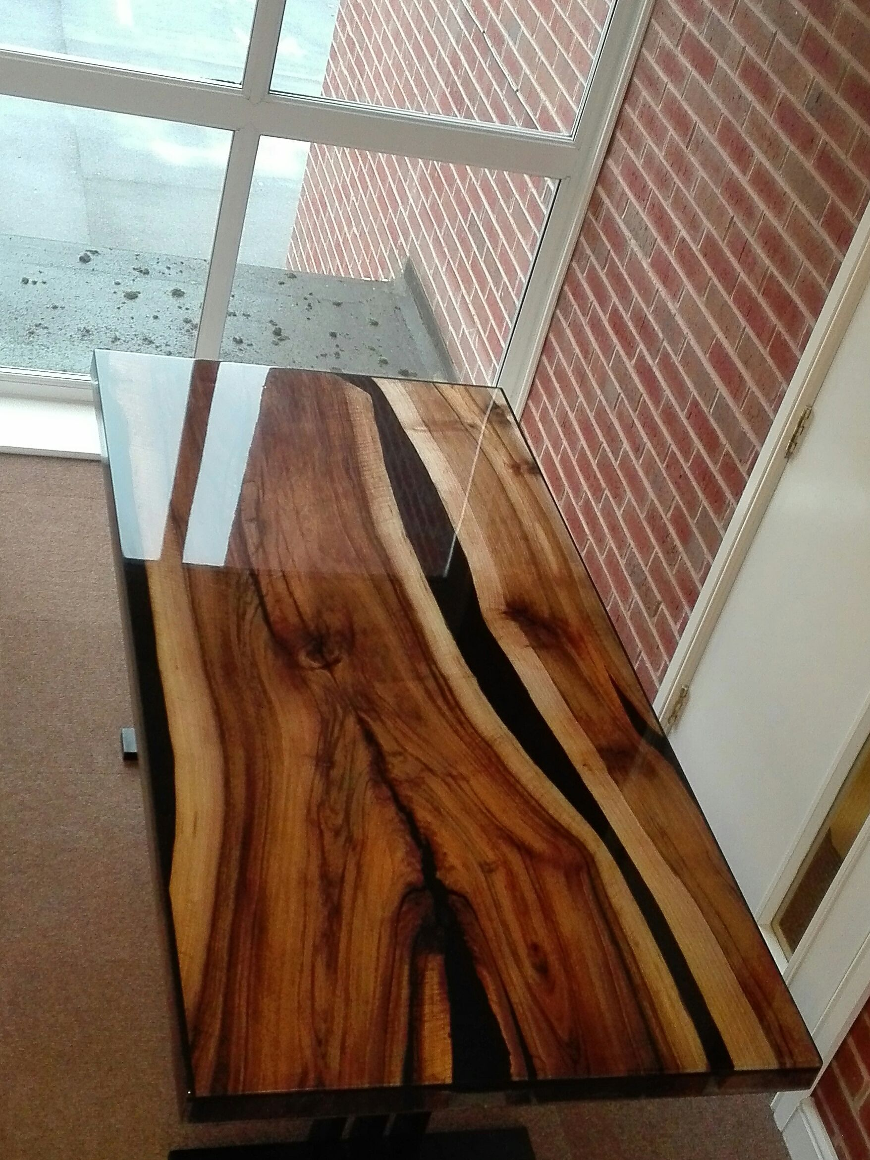 A Hand Made Dining Table From Walnut Flooded With Resin Only One
