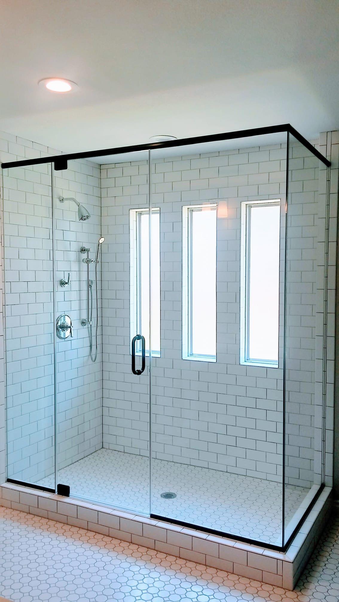 White Subway Tile With Matte Black Frameless Glass Shower Enclosure Corner Shower Enclosures Glass Shower Enclosures Shower Doors