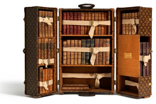 "Louis Vuitton Library Trunk - Carnavalet Museum (Paris) exhibition of the French luggage firm's most memorable travel trunks, entitled ""A Journey into the Capital, Louis Vuitton and Paris"""