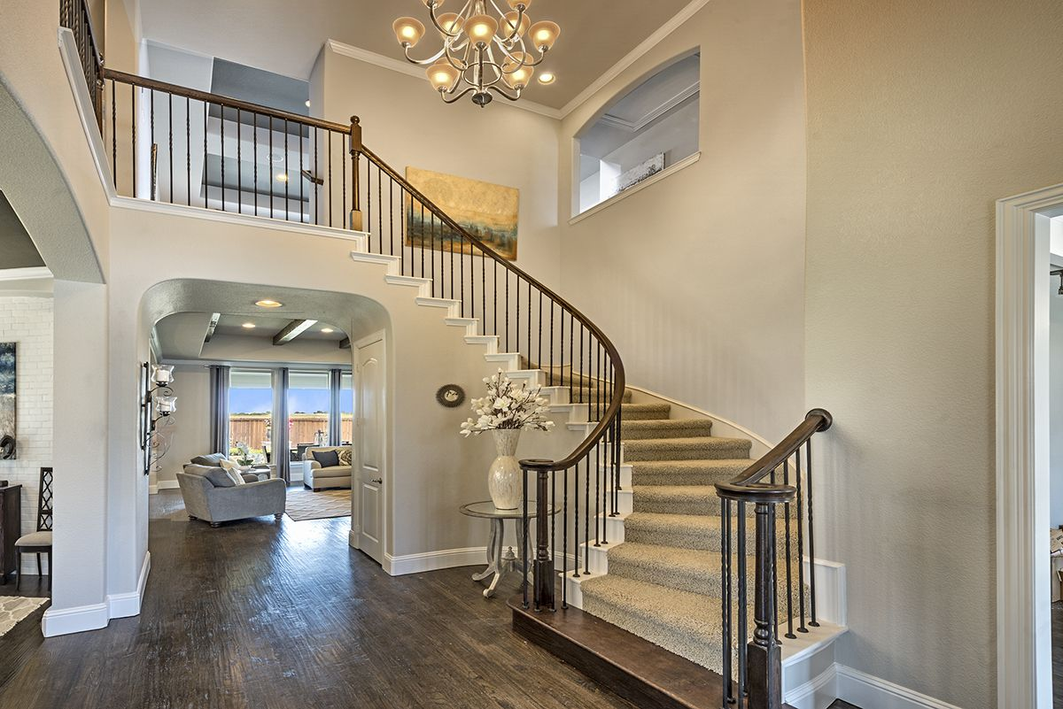 A Beautiful Grand Staircase In The Foyer To Extend A Warm Welcome