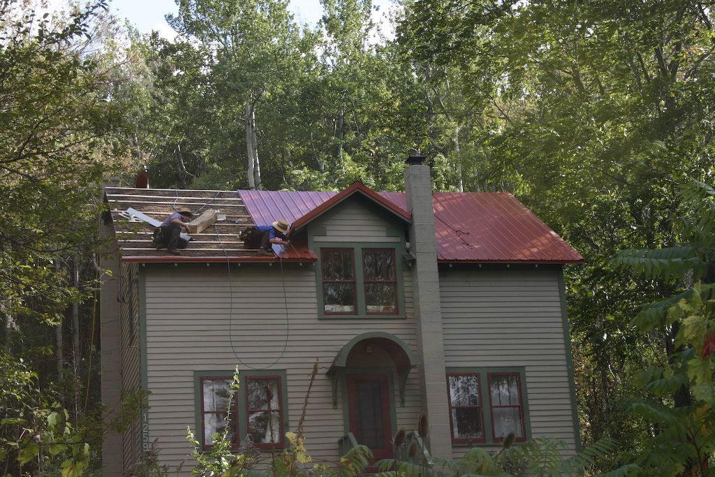 Red metal roof houses roofing soffits gutters roofing for Metal roof on houses pictures